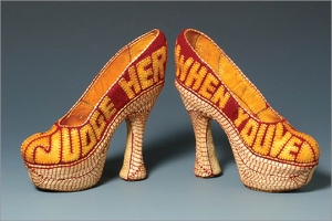 Jan Hopkin's stiletto sculpture, Tolerance, crafted out of dried fruit skins